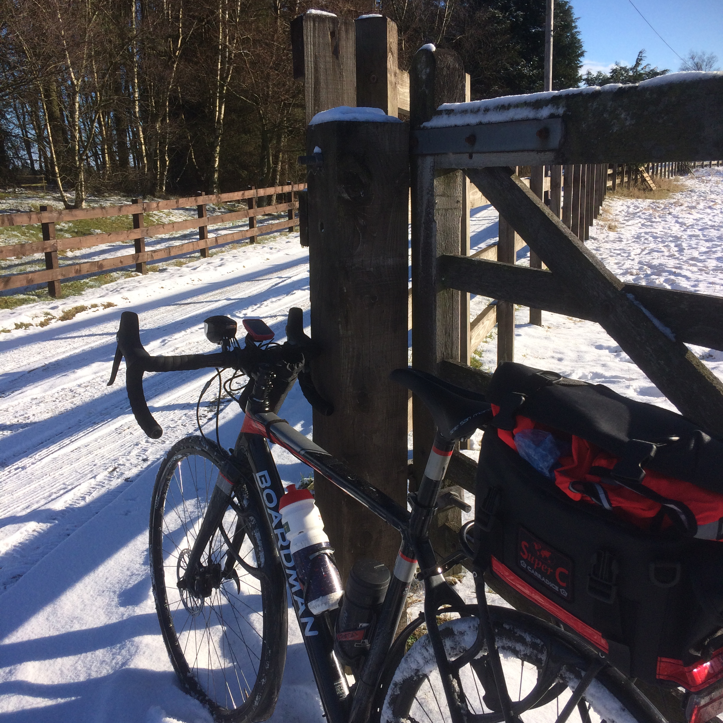 Bike by a snowy track.